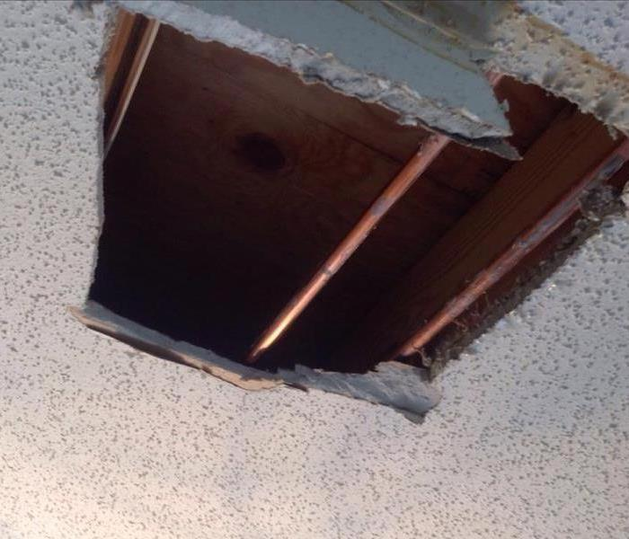 Ruptured Pipe in Kitchen Ceiling