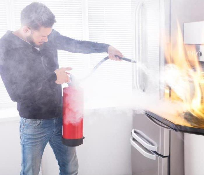 guy standing with fire extinguisher